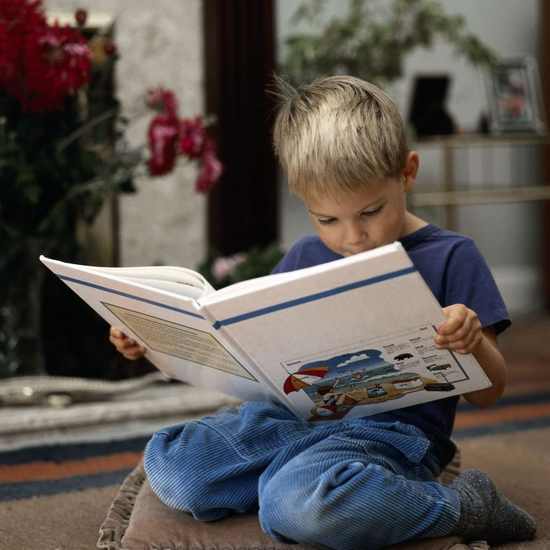 little boy reading big book