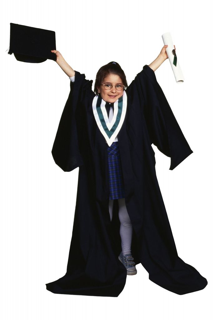 youth dressed as college graduate