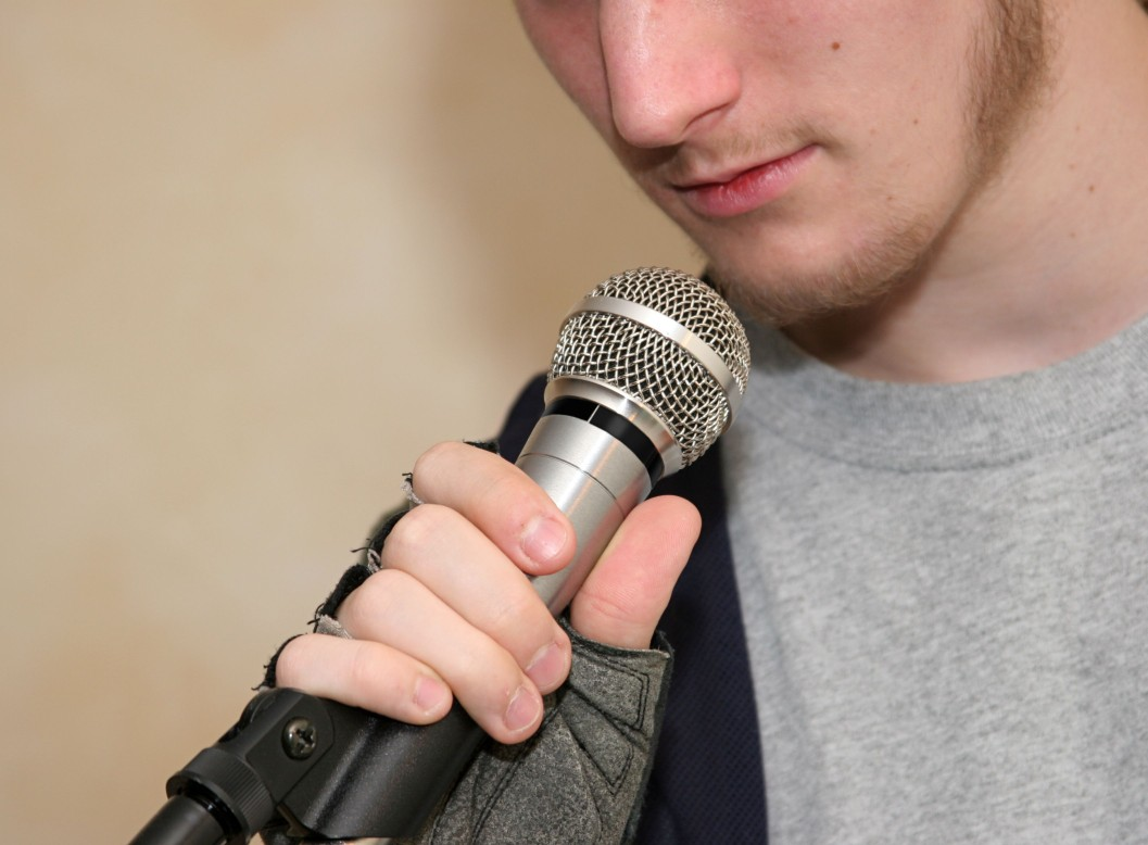 teen with microphone