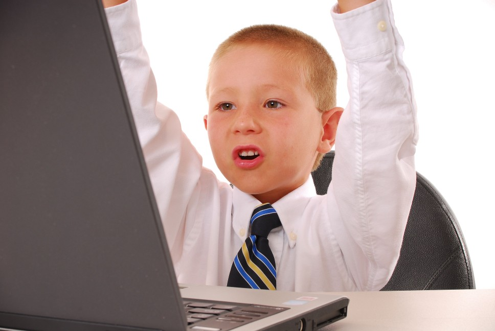 triumphant boy with computer