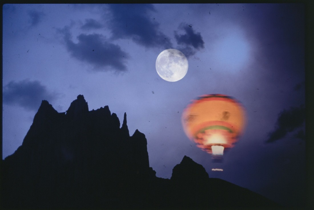 hot air balloon at night with moon