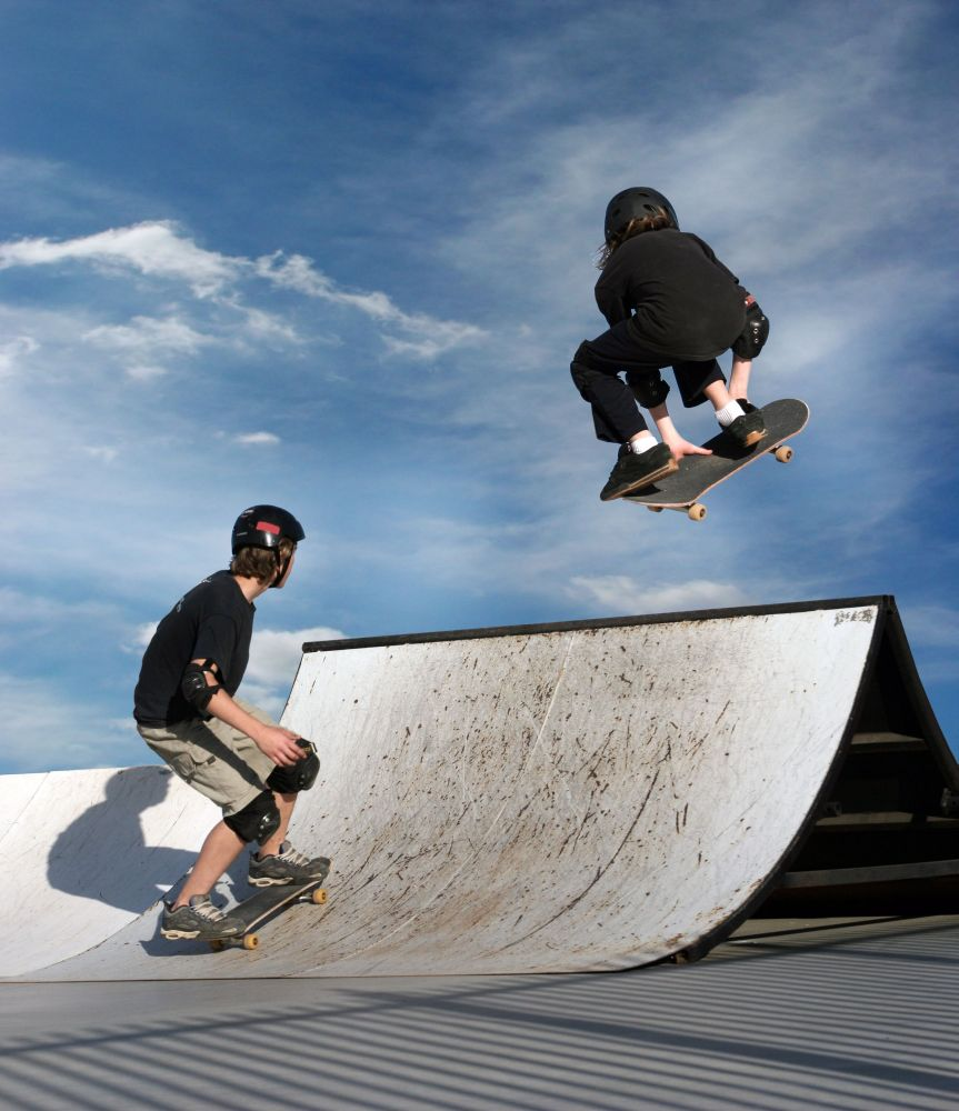 youth skateboarding on ramp