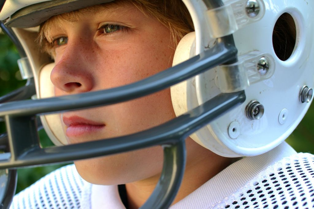 youth in football helmet