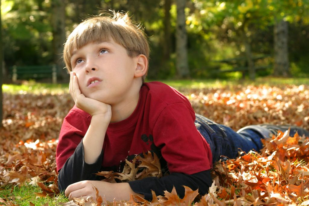boy in nature thinking
