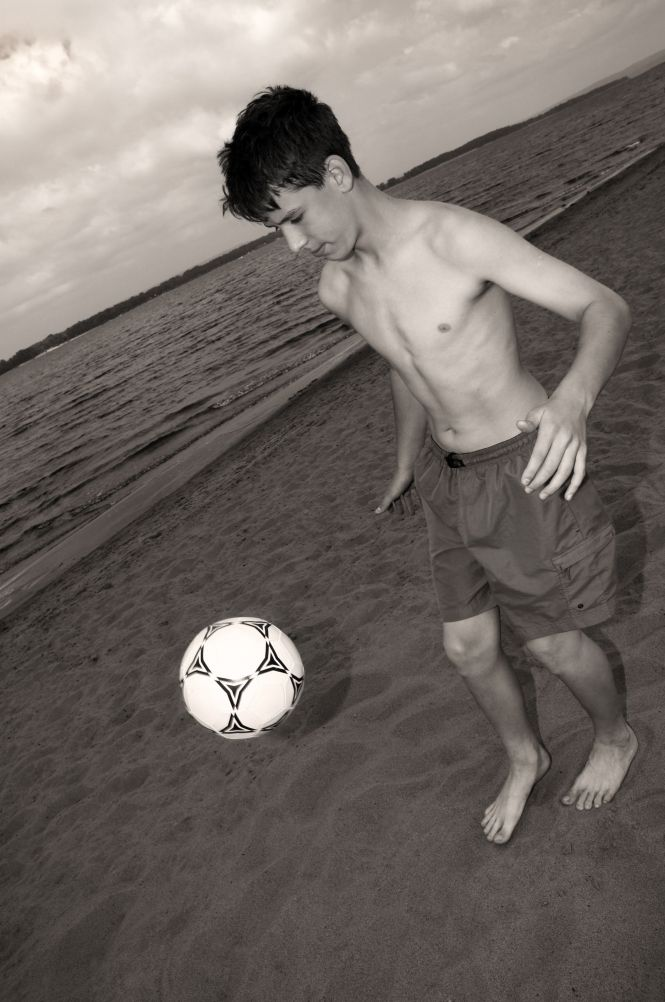 teen with soccer ball