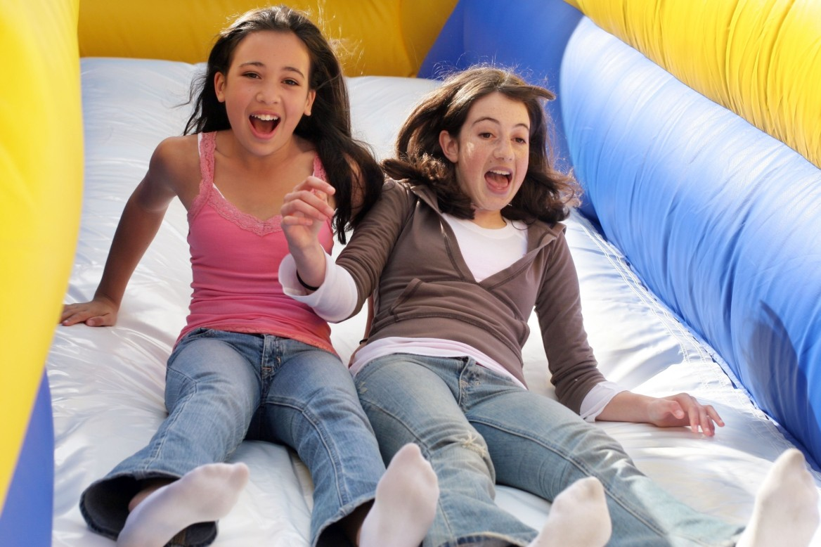 two girls on amusement park slide
