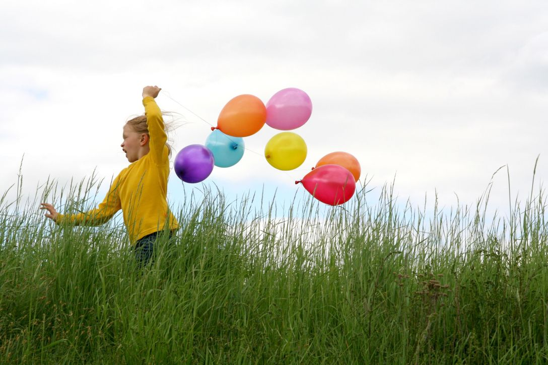 girl with multi colored balloons