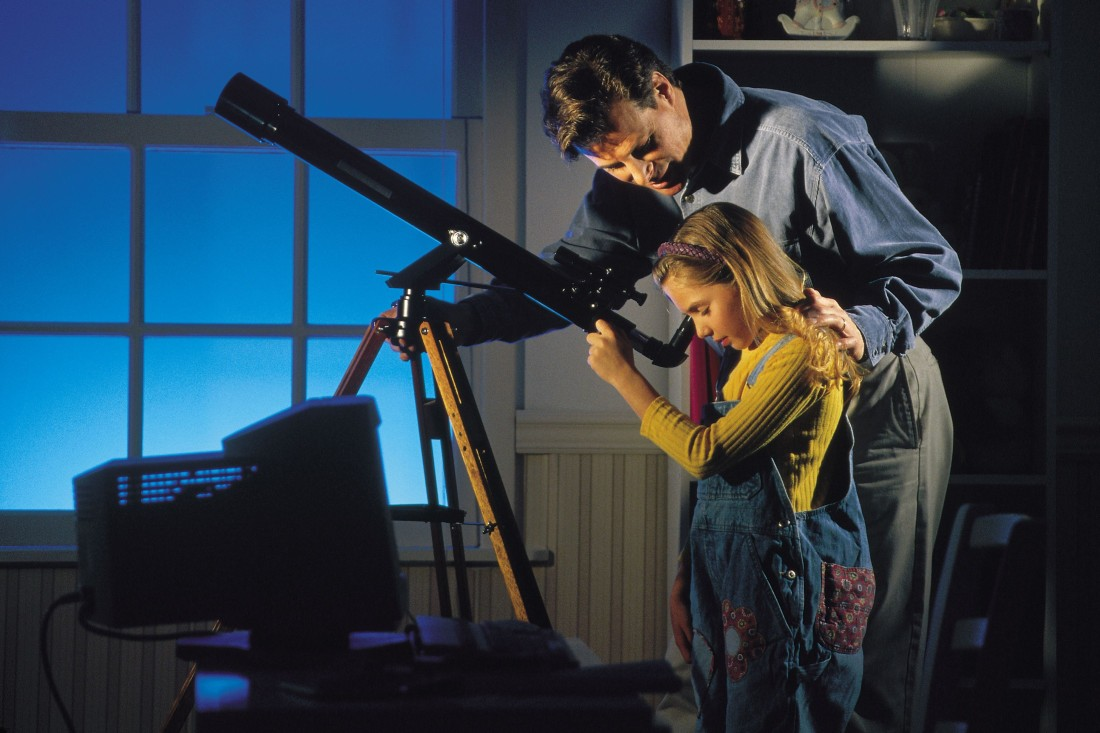 man and girl with telescope
