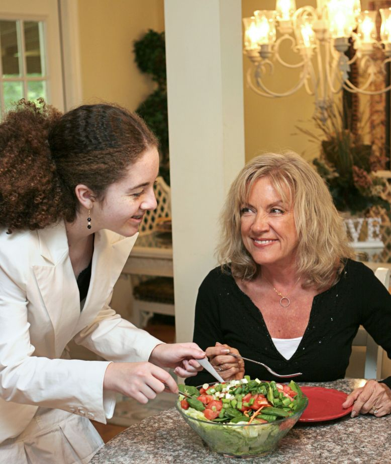 girl serving woman dinner