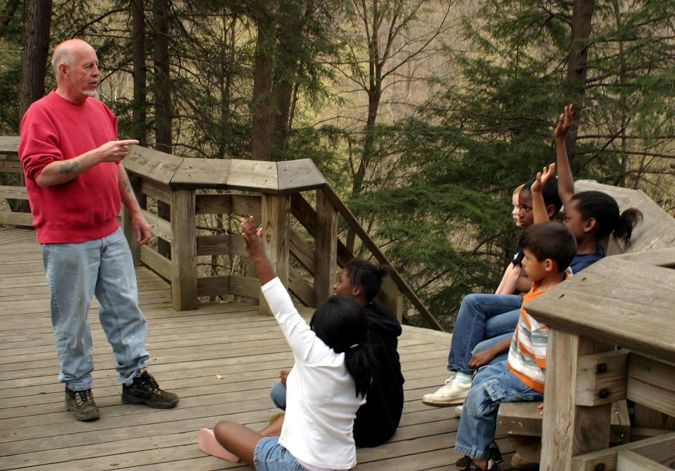 adult and youth learning outdoors